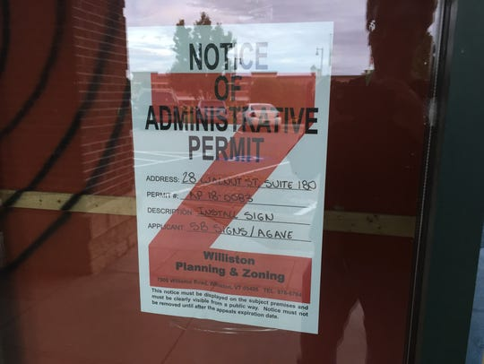 A zoning permit sign is on the space at 28 Walnut St.