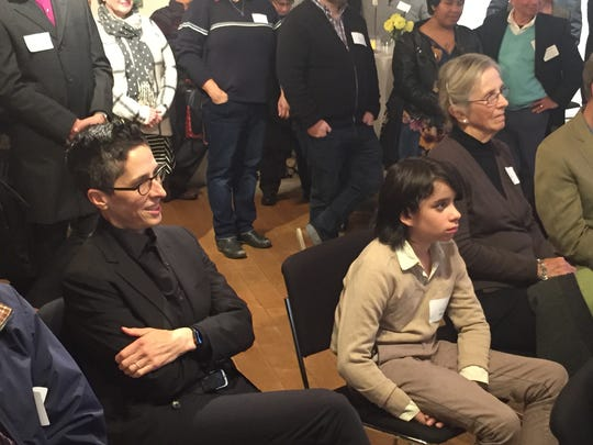 """Alison Bechdel, author of the graphic novel """"Fun Home,"""" listens as Broadway performer Beth Malone speaks Friday at a fundraiser for The Samara Fund at The BCA Center in Burlington."""