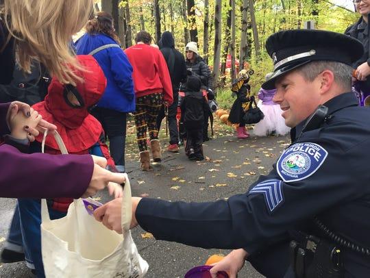 Port Huron Police Sgt. Brian Kerrigan hands out treats