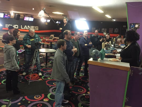 Director Cindy Maples, at left, helps the cinematographer work out a shot as, from foreground, Leo Kempf, Paul Nicely, Rusty James and Will Chase run their lines with Gina Moore inside Henderson's Echo Lanes last October.