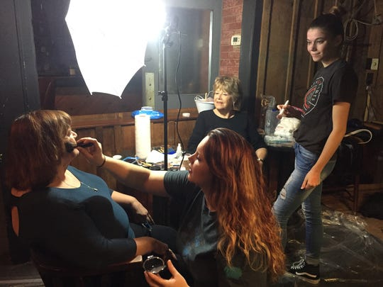 Sharon Dennis gets her on-set makeup applied by Cassandra Baker as Mary Clementes Minnette, center, and Chandra Gauer look on. Minnette is of Henderson, and the other women are from Evansville.