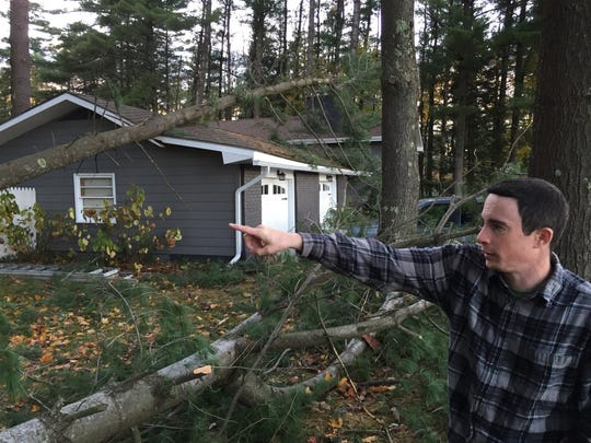 Brad Sylva assesses the damage to his property on Walker Hill Road in Williston on Monday, October 30, 2017 after a windstorm.