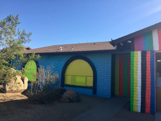 Peoria resident Ernie Leas painted a rainbow of stripes and a flashy blue front on his home in October, trying to use as many colors as possible.