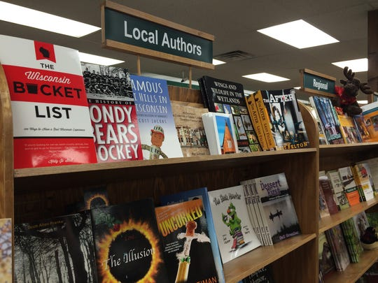 In this 2014 file photo, a shelf inside the Manitowoc Book World displays books by Wisconsin authors.