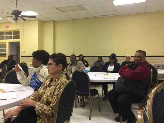 The audience listens to speakers during a public forum on Monday, Oct. 30 in Accomac, Va. The forum's topic was an upcoming referendum on the school board selection method in Accomack County.