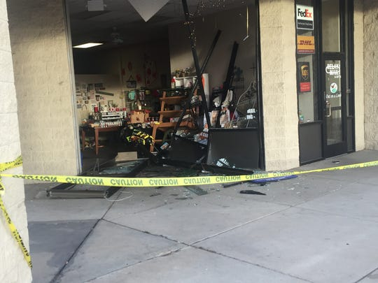 The scene of an incident involving a vehicle hitting businesses in the Riverside Shopping Center in Fort Collins.