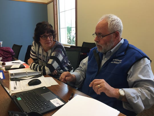 Visiting Nurse Services health-insurance navigator Mike Tramontina helps Deb Hanson of Mason City understand her options under the Affordable Care Act in November 2017 at the Mason City Public Library. Iowa no longer has any federally financed health insurance navigators.