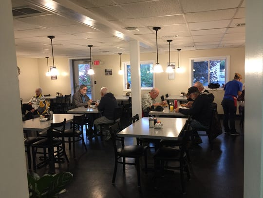 The early morning crowd at the Hi-Hat Cafe has breakfast
