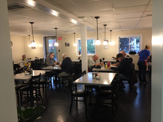 The early morning crowd at the Hi-Hat Cafe has breakfast as word spread through town that a terrorism suspect had been pulled over and cited for failing a truck inspection.