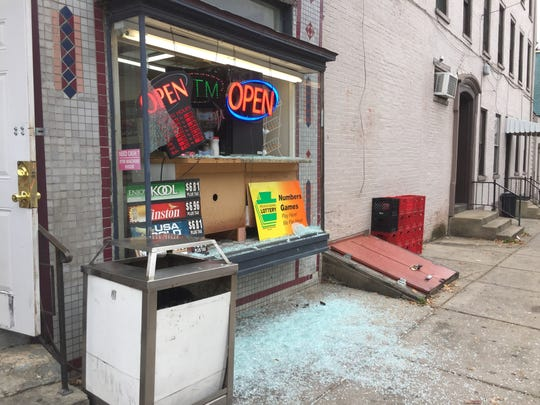 The storefront window of a corner store at East Philadelphia and North Queen streets in York was shot out around lunchtime Wednesday.