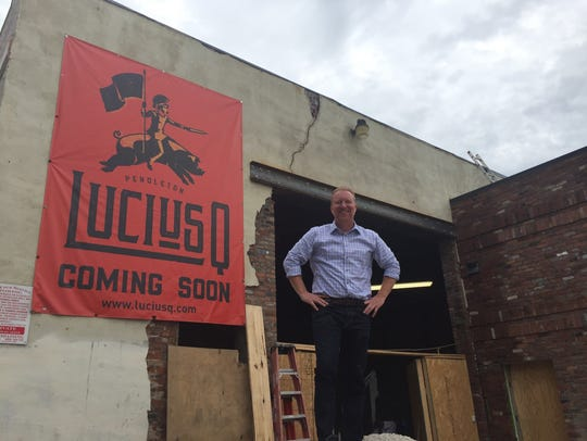 Aaron Sharpe in front of what is now LuciusQ restaurant in Pendleton.