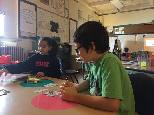 Fifth graders Aaliyah Williams and Trystan Moore play