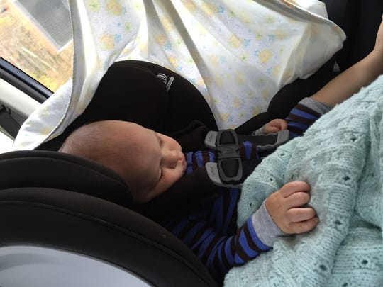 Victoria Freile's son Joe naps in the car during a