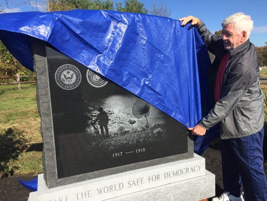 636452317681929039-Ed-Holland-covers-the-first-World-War-I-monument-to-the-89-killed-in-action-from-Burlco-for-dedication-in-Medford-s-Freedom-Park-Nov-4-2017.JPG