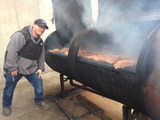 Full Service BBQ general manager David Puleo stokes