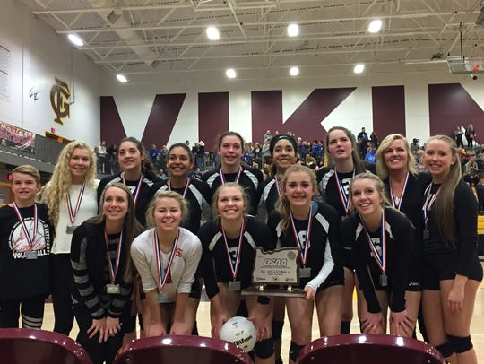 The Santiam Christian volleyball team poses with the
