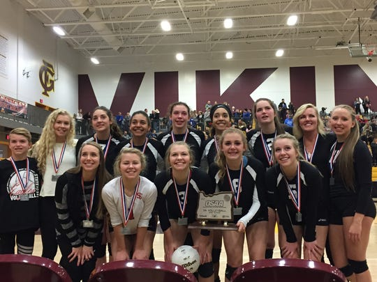 The Santiam Christian volleyball team poses with the second-place trophy after the OSAA Class 3A state championship match at Forest Grove High School on Nov. 4, 2017.