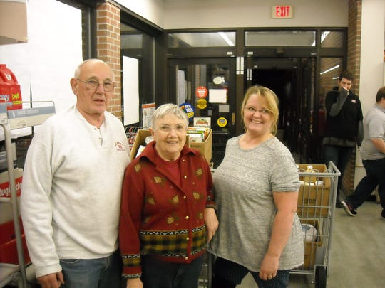3. Dick Clark, owner of Dryden Food Mart; Aiden Payne, co-coordinator of the Dryden Kitchen Cupboard, winner of this year's Dryden Rotary Food Run; and Cyndie Allmendinger, who gathered $333.90 worth of food for the Kitchen Cupboard in 3 minutes.