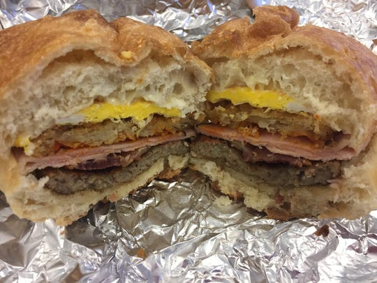 "An interior shot of a breakfast sandwich from the Aviation Deli on Airport Drive in South Burlington on Nov. 6, 2017. The flavor strata which includes three meats made this so called ""Wee Little Johnny"" pack a serious bite."