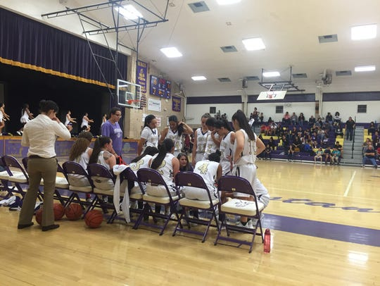 The Burges girls basketball team gets instructions