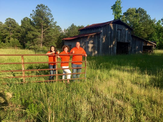 Tom Hampton, right, with his daughter, McKenzie, left, and wife, Kristi, at their farm near Pelzer.