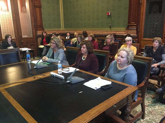 UnitedHealthcare executive Kim Foltz, left, AmeriHealth executive Cheryl Harding, center, and Amerigroup executive Cynthia MacDonald testify before a Medicaid oversight committee Wednesday at the Iowa Statehouse.
