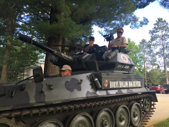 "John Kulhavi in his tank at ""Camp Kulhavi"" in northern Michigan with Keith Famie and videographer James Saoud during the filming of ""ENLISTED."""