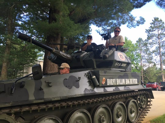"""John Kulhavi in his tank at """"Camp Kulhavi"""" in northern Michigan with Keith Famie and videographer James Saoud during the filming of """"ENLISTED."""""""