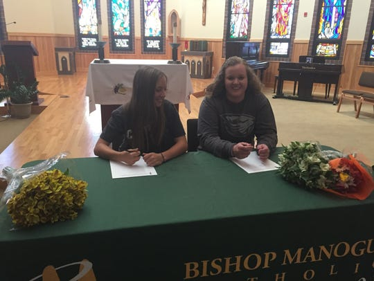 Kasey Reynolds, left, and Bailey McLaughlin signed