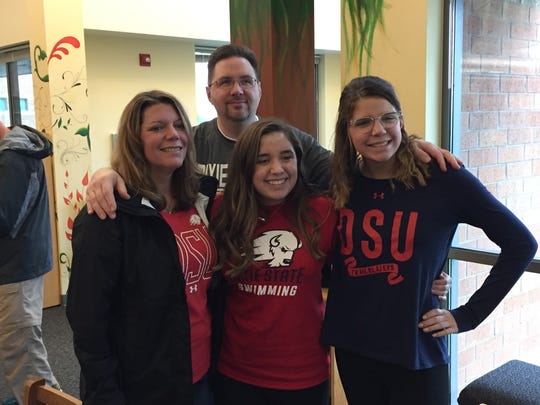 West Salem senior Alaina Otterstrom (center) signed a letter of intent to compete in swimming at Dixie State.