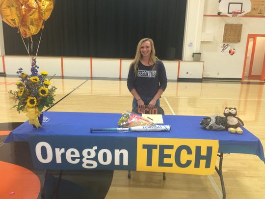 Scio softball player Rheanna McDaniel signs to play at Oregon Tech on Wednesday in the Scio gym.