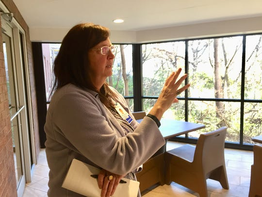 Broadlawns Medical Center psychiatrist Janice Landy shows an enclosed porch overlooking a ravine at the hospital's new inpatient psychiatric unit.