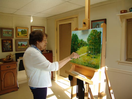 Esther Marie Versch in her art studio and gallery.