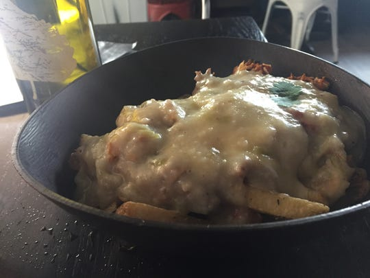 Green Chile and Chicken Poutine ($13) is the perfect dish to pair with the Bosque IPA at Bosque Brewing Company.
