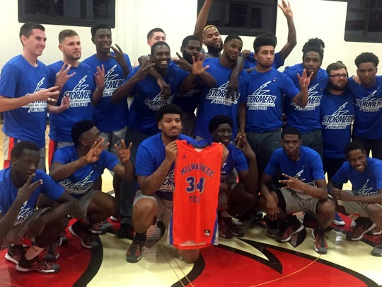 Members of MATC's basketball team, with Will Kellerman's jersey, honor their teammate following a victory days after his death last November.