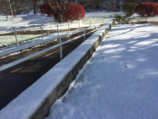 Light snowfall dusted the roads in Binghamton Friday