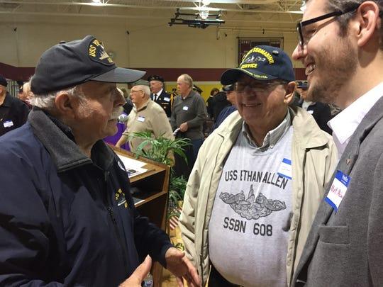 Navy veterans Herbert McIntosh, left, John Rushton and Matthew McLaughlin converse after a Veterans Day assembly at Fort Gratiot Middle School.