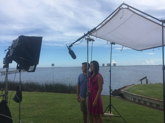 "Josh and Cristina Harty pose for a photo during filming of an HGTV episode of ""Beach Hunters"" earlier this year."