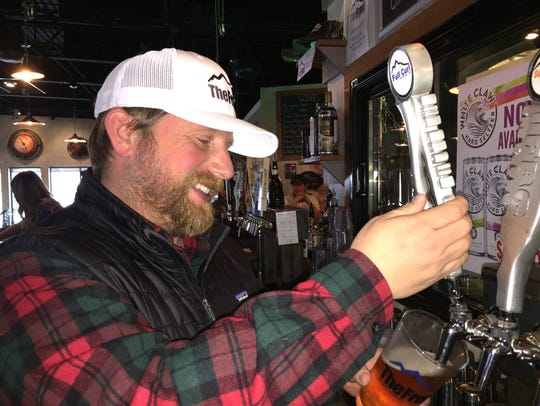 Front Brewing Co.  manager Jeremiah Johnson pours a