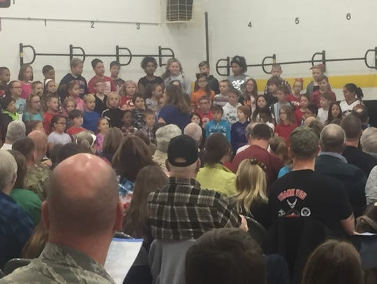 Students sing patriotic song during Monday morning's