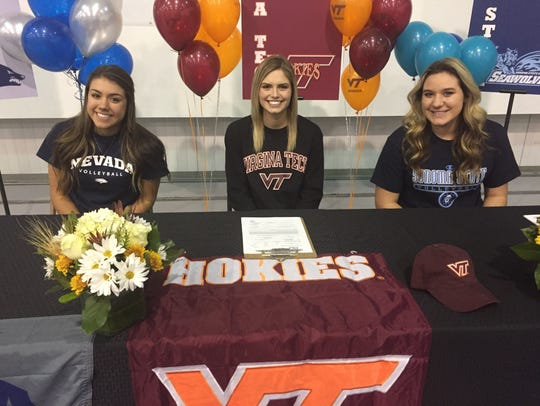 Left to right - McQueen's Kaila Spevak, signed with