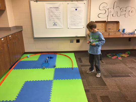 Matthew Fisher, 7, guides a sphero through an app in