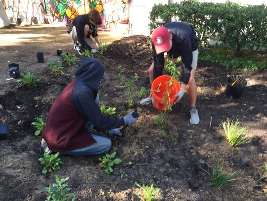 Scouts work on rain garden at Frenchtown Heritage Hub