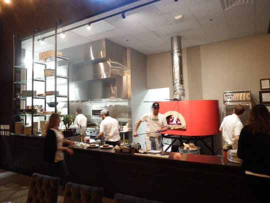 The open kitchen at the new Iowa River Landing restaurant