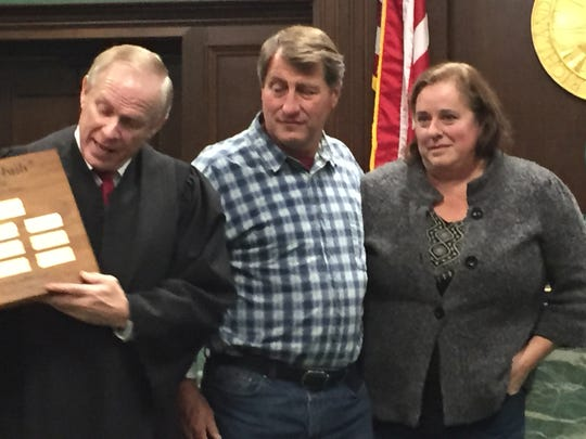 Richland County Juvenile Court Judge Ron Spon presents the Love Never Fails award to Bob and Kati Gardner.
