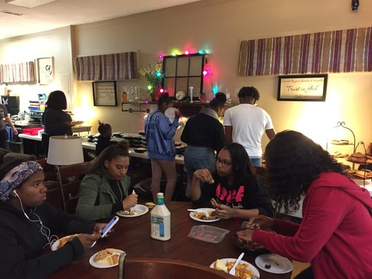 Students eat dinner offered at Hillcrest Community