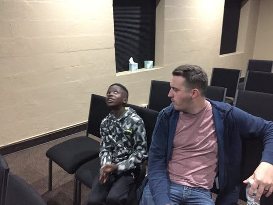 Athian Madut, 12, left, talks with Hillcrest Community Church pastor Chris Phillips at a Wednesday night program for youth.