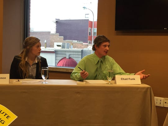 Meghan Brence listens as Chad Funk makes a point about beginning farmers during the Farm Bureau Collegiate Discussion Meet. Both were named winners in the competition which was held Sunday afternoon, November 12,  during the Montana Farm Bureau Convention in Billings.