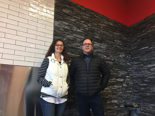 Dawn and Jim Combs stand in their new restaurant, which