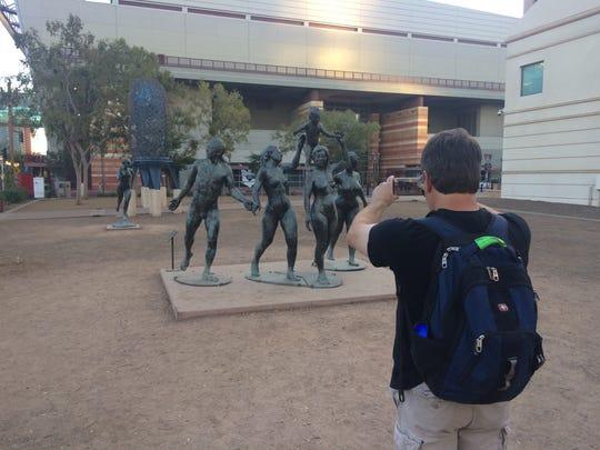 Joe Petterle of Las Vegas takes a photo of the naked